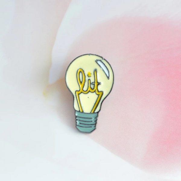 Lit lightbulb pin